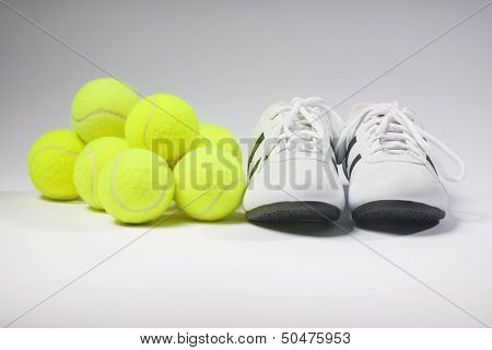 Tennis Sneakers And Tennis Balls. Concept