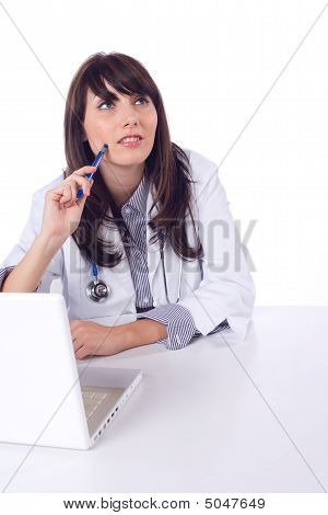 Female Doctor On Computer At Desk