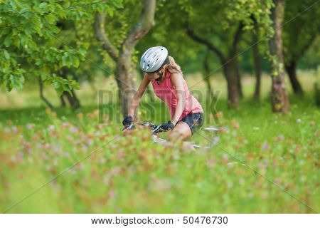 Young Female Cyclist Practicing Outdoors
