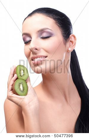 Young attractive healthy woman smiling eyes closed, holding kiwifruit in hand.