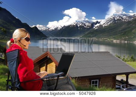 Woman Working On The Lake Shore