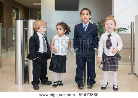 Four children with surprised faces in the Business center near the turnstile