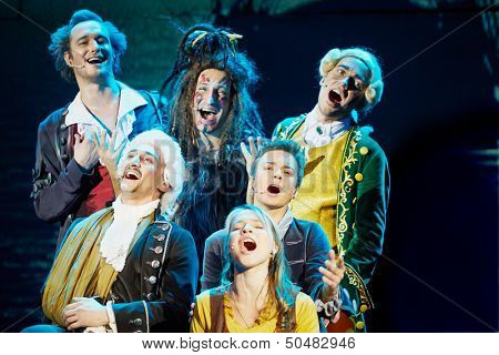 MOSCOW - DEC 15: Group of actors sing on stage at Big Concert Hall Izmailovo during musical spectacle for children Treasure Island, December 15, 2012, Moscow, Russia.