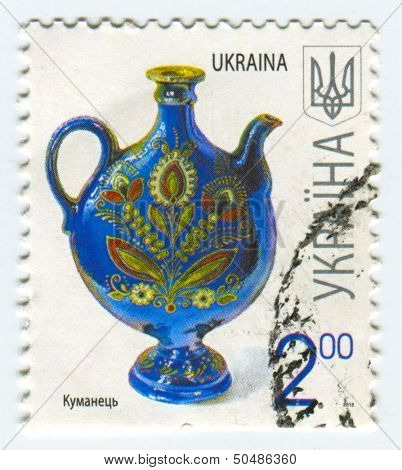 UKRAINE - CIRCA 2013: A stamp printed in Ukraine shows image of the Kumanets (also occasionally Koeman) - ceramic figural vessel, which is now mainly used as decoration, circa 2013.