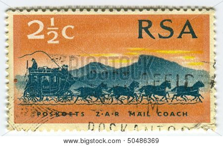 RSA - CIRCA 1986: A stamp printed in RSA shows image of  the mail coach or post coach was a horse-drawn carriage that carried mail deliveries, circa 1986.