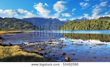 Stony shallows. A wonderful summer day in the shallow river. Chilean Patagonia, the road Carretera Austral