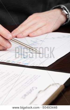 Business Men Reading Contract.