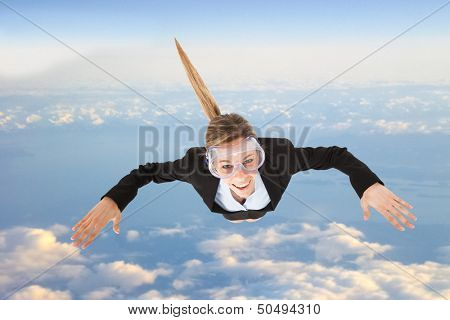 Portrait of funny business woman skydiving