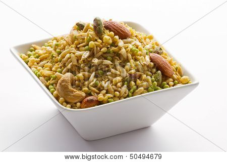 Indian snack in white bowl isolated.