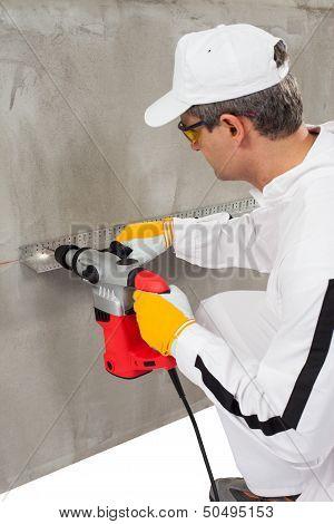 Worker Making A Hole Through A Lath