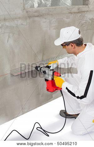 Worker Making A Hole Trough A Lath