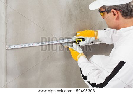 Worker Measuring The Level Of A Lath