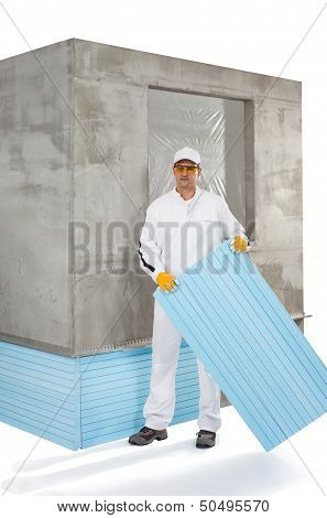 Worker Holding An Insulation Panel