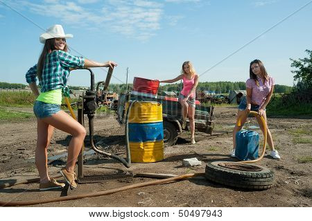young women on old gasoline station