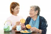 pic of polite girl  - Friendly nurse cares for an elderly woman - JPG