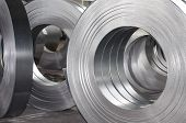 stock photo of tin man  - sheet metal tin rolls abstract industrial concept - JPG