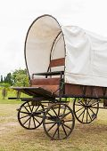 pic of covered wagon  - Covered wagon with white top in park - JPG