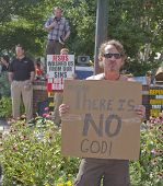 Men Hold Opposing Religion Signs At Bele Chere Festival In Asheville, Nc