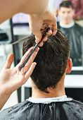 pic of beauty parlour  - Hairdresser making haircut to young man at beauty parlour - JPG