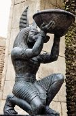 picture of horus  - sculpture of an Egyptian Anubis holding a bowl - JPG