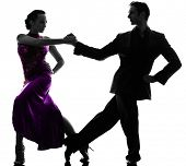 one caucasian couple man woman ballroom dancers tangoing  in silhouette studio isolated on white bac