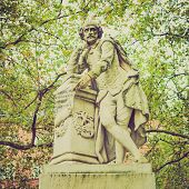 pic of william shakespeare  - Vintage looking Statue of William Shakespeare (year 1874) in Leicester square London UK