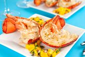 stock photo of lobster tail  - Grilled lobster tails with mango salsa - JPG
