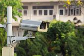 stock photo of cctv  - CCTV or security camera in front of a door - JPG