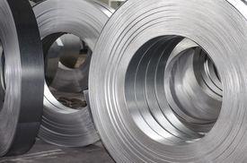 pic of tin man  - sheet metal tin rolls abstract industrial concept - JPG