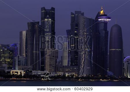 Towers in the business district of Doha, Qatar, in the blue light of dusk.