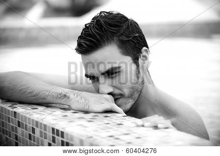 Young man relaxing on a luxury rooftop