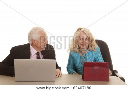 Elderly Couple Business Computers He Looks At Her