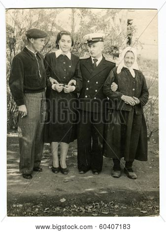 MOSCOW, USSR - CIRCA 1950s : An antique photo shows officer of the Navy and his family.