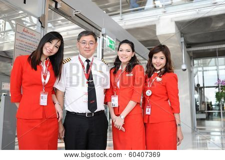 BANGKOK - OCT 27: Airasia crew members in Bangkok Airport on October 27, 2011 in Bangkok, Thailand. AirAsia Berhad is a Malaysian low-cost airline headquartered in Kuala Lumpur, Malaysia