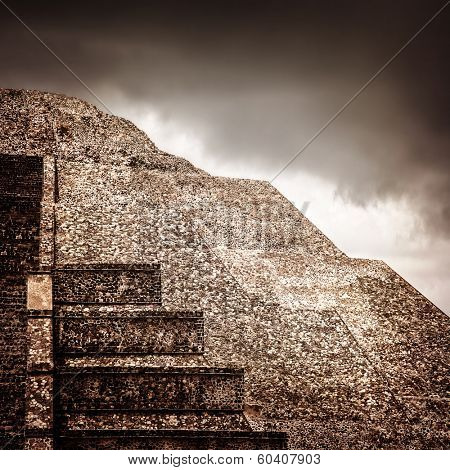 Famous Mexican pyramid, ancient religious ruins on North America, overcast weather, cloudy sky, pre-columbian architecture, Aztec heritage