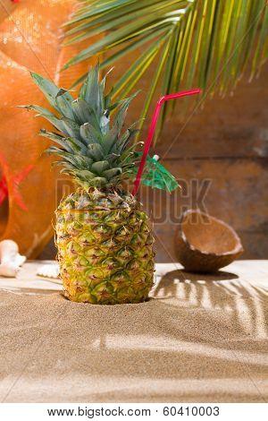 Pineapple cocktail at summer beach resort on the sand