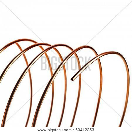 copper pipes close up isolated on white background