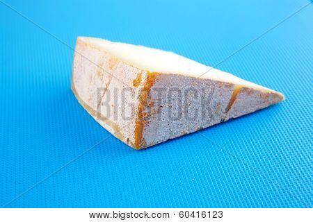light gouda on blue plastic board
