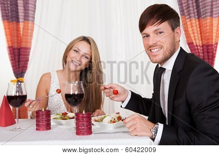 Young Couple Enjoying A Romantic Dinner