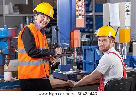 Production Worker At Workplace And Supervisor