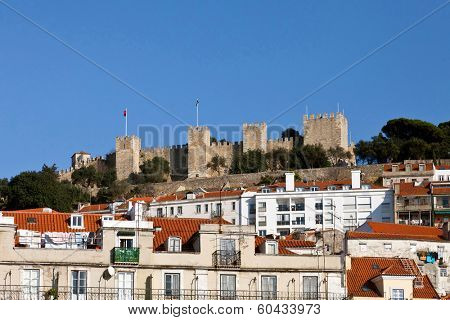 View of the Sao Jorge Castle from the Baixa (Downtown) District of Lisboa, Portugal. One of the landmarks of the Portuguese Capital.