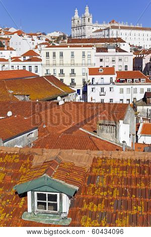 Sao Vicente de Fora Monastery seen from Miradouro das Portas do Sol (terrace) with Alfama District rooftops. Lisbon, Portugal.