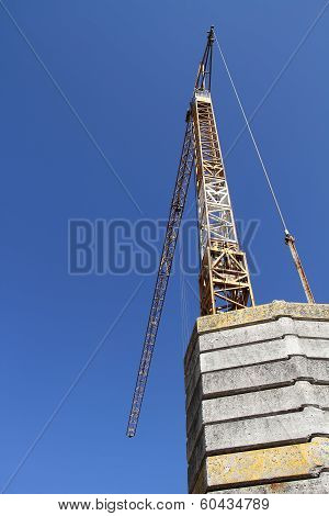 A cranes on sky background