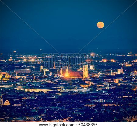 Vintage retro hipster style travel image of night aerial view of Munich from Olympiaturm (Olympic Tower). Munich, Bavaria, Germany