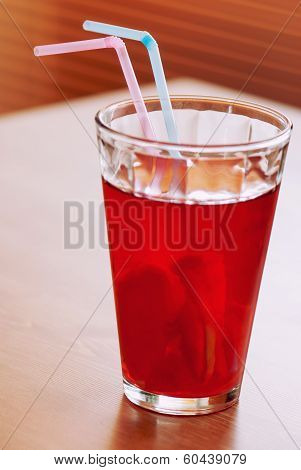 Cup Of Lemonade With Two Colored Straws