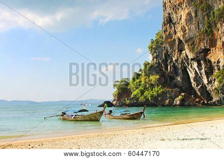 Holiday Vacation Concept Background - Long Tail Boat On Tropical Beach With Limestone Rock, Krabi