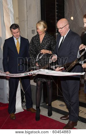 NEW YORK-JAN 28: (L-R) Jeffrey Fowler, Cameron Diaz and Stephane Linder attend a ribbon cutting at the Tag Heuer Flagship Fifth Avenue store opening on January 28, 2014 in New York City.