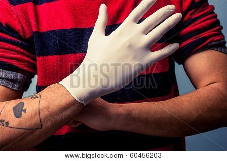 Tattoo Artist Putting On Latex Glove