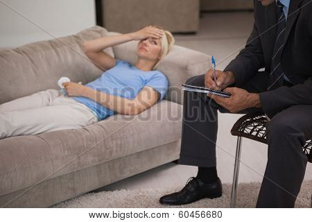 Young woman in meeting with a male psychologist in his office