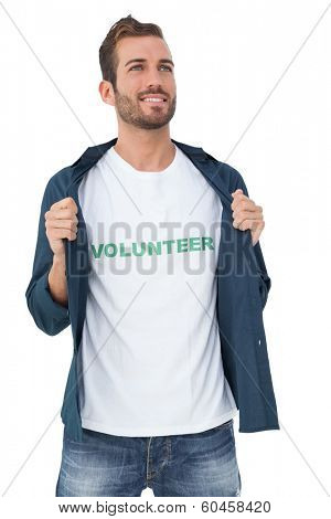 Portrait of a smiling young male volunteer standing over white background